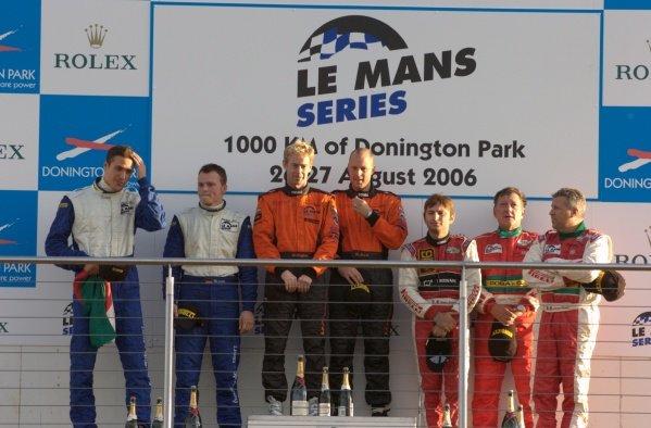 GT2 podium and results:1st: Warren Hughes (GBR) / Robert Bell (GBR) Team LNT, centre.2nd: Joel Camathias (SUI) / Marc Lieb (GER) Autorlando Sport, left.3rd: Andrea Montermini (ITA) / Gabrio Rosa (ITA) / Luca Drudi (ITA) GPC Sport, right.Le Mans Series, Rd4, Donington Park, England, 28 August 2006.DIGITAL IMAGE