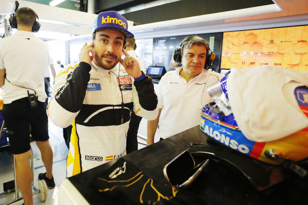 Fernando Alonso, McLaren, prepares in the garage