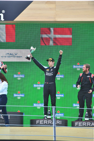 Christian Lundgaard (DNK, ART Grand Prix), 3rd position, with his trophy on the podium