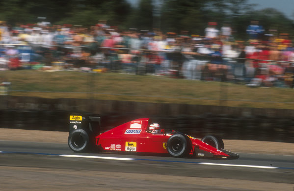 1990 British Grand Prix.Silverstone, England.13-15 July 1990.Nigel Mansell (Ferrari 641). He was leading the race when his gearbox began to malfunction, until finally on lap 55 it failed completely.Ref-90 GB 22.World Copyright - LAT Photographic