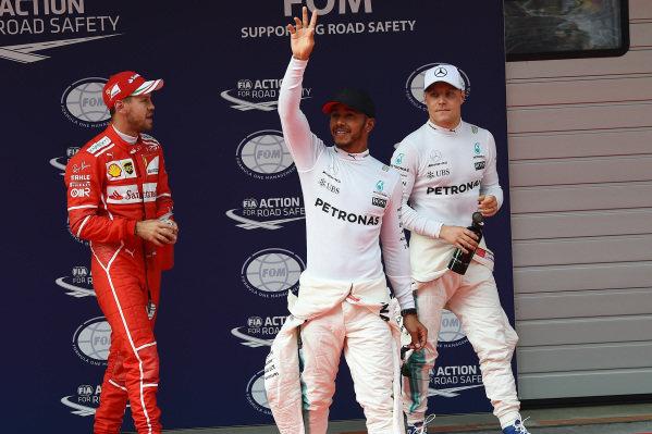 Sebastian Vettel (GER) Ferrari, pole sitter Lewis Hamilton (GBR) Mercedes AMG F1 and Valtteri Bottas (FIN) Mercedes AMG F1 celebrate in parc ferme at Formula One World Championship, Rd2, Chinese Grand Prix, Qualifying, Shanghai, China, Saturday 8 April 2017.