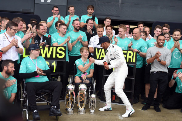 Race winner Lewis Hamilton (GBR) Mercedes AMG F1 celebrates with the trophies alongside his brother Nick Hamilton (GBR), Billy Monger (GBR) and the team at Formula One World Championship, Rd10, British Grand Prix, Race, Silverstone, England, Sunday 16 July 2017.