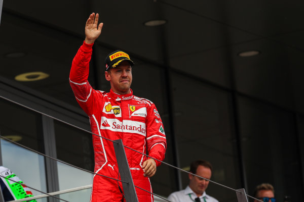 Sebastian Vettel (GER) Ferrari celebrates on the podium at Formula One World Championship, Rd9, Austrian Grand Prix, Race, Spielberg, Austria, Sunday 9 July 2017.