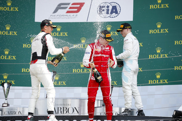 HUNGARORING, HUNGARY - AUGUST 04: Leonardo Pulcini (ITA) Hitech Grand Prix, Race winner Marcus Armstrong (NZL) PREMA Racing and Jake Hughes (GBR) HWA RACELAB celebrate on the podium with the champagne during the Hungaroring at Hungaroring on August 04, 2019 in Hungaroring, Hungary. (Photo by Joe Portlock / LAT Images / FIA F3 Championship)