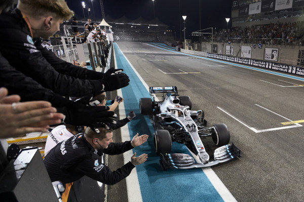 Lewis Hamilton, Mercedes AMG F1 W10, 1st position, passes his team on the pit wall as they celebrate