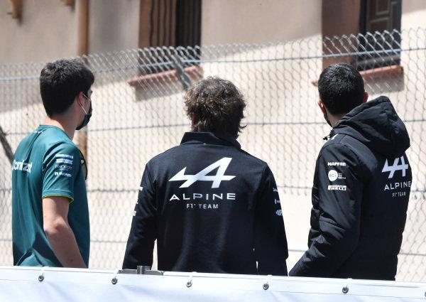 Lance Stroll, Aston Martin, Fernando Alonso, Alpine F1, and Esteban Ocon, Alpine F1, in the drivers parade