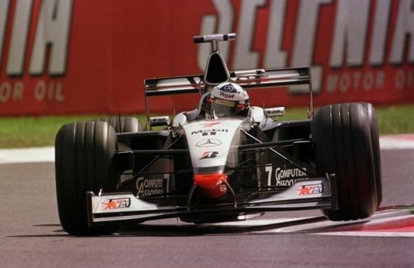 1998 Italian Grand Prix.Monza, Italy.11-13 September 1998.David Coulthard (McLaren MP4/13 Mercedes-Benz) bounces over the kerbs.World Copyright - LAT Photographic