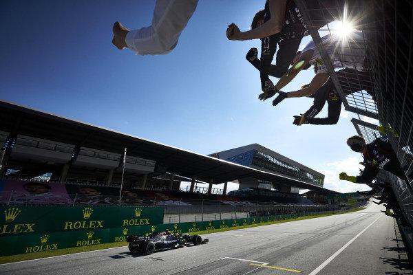 Valtteri Bottas, Mercedes-AMG Petronas F1, crosses the line to win the race