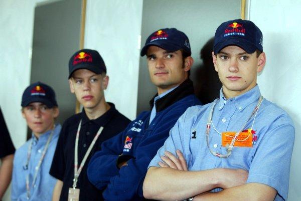 Martin Ragginger (AUT), Sebastian Vettel (GER), Vitantonio Liuzzi (ITA), Bernhard Auinger (AUT) Red Bull Junior drivers from the various categories. Austrian Grand Prix, A1-Ring, 10 May 2002. DIGITAL IMAGE
