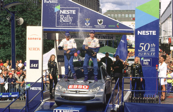 WRC Neste Rally of Finland 200017th - 20th August 2000. Rd 9/13.Rally winner Marcus Gronholm, Peugeot , podium.Photo:McKlein/LATRef 35mm A16