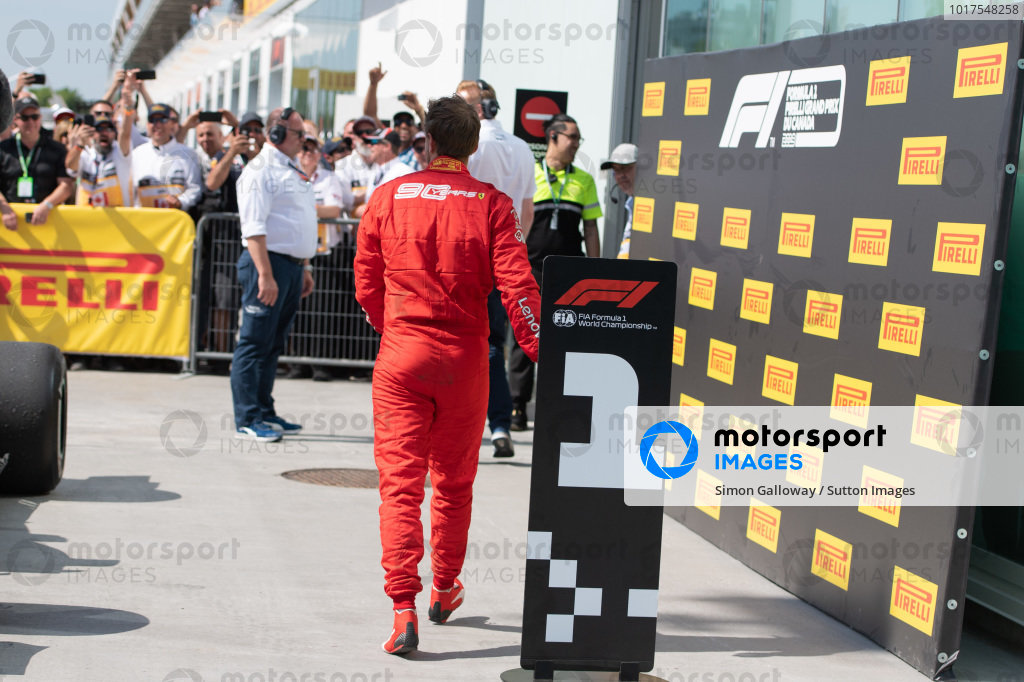 Sebastian Vettel, Ferrari, 2nd position, heads for the podium after correcting the position boards in front of the cars