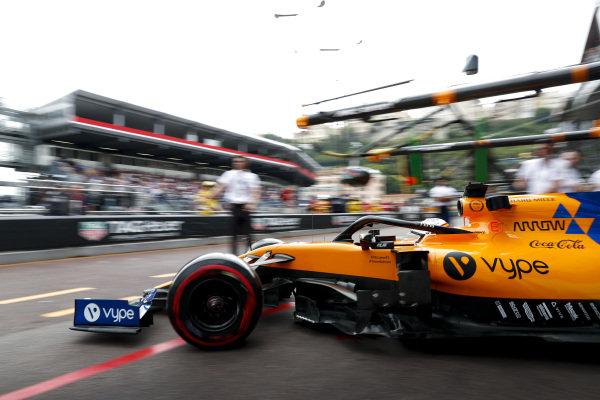 Carlos Sainz Jr., McLaren MCL34 drives out of the garage
