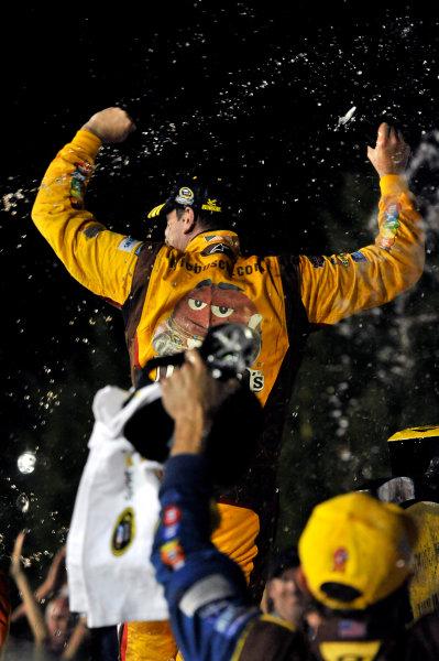 30 August - 1 September 2013, Hampton, Georgia, USA Kyle Busch, M&M's Toyota Camry celebrates his win in Victory Lane © 2013, Nigel Kinrade LAT Photo USA