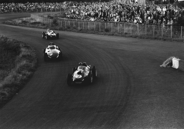 Nurburgring, Germany. 1 - 3 August 1958.Peter Collins (Ferarri Dino 246), retired, leads Tony Brooks (Vanwall) 1st position and Mike Hawyhorn (Ferrari Dino 246), retired. Collins would later suffer a fatal accident while leading the race, action. World Copyright: LAT Photographic.Ref:  7990 - 22.