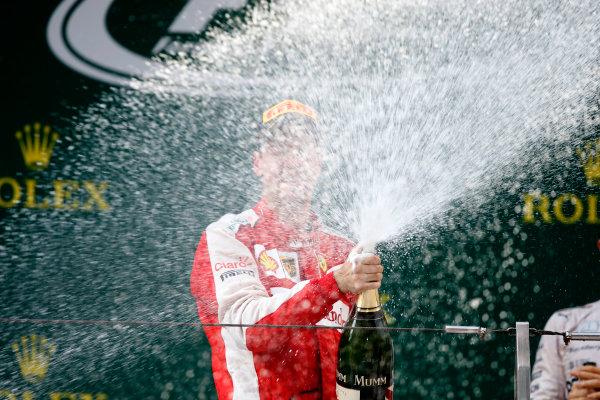 Shanghai International Circuit, Shanghai, China. Sunday 12 April 2015. Sebastian Vettel, Ferrari, 3rd Position, sprays Champagne on the podium. World Copyright: Glenn Dunbar/LAT Photographic. ref: Digital Image _W2Q5942