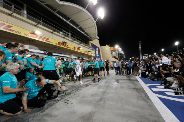 Bahrain International Circuit, Sakhir, Bahrain. Sunday 19 April 2015. Lewis Hamilton, Mercedes AMG, 1st Position, Nico Rosberg, Mercedes AMG, 3rd Position, and the Mercedes team celebrate victory. World Copyright: Alastair Staley/LAT Photographic. ref: Digital Image _79P9211