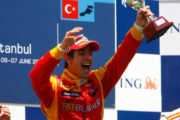 Sunday Race. 7th June 2009. Lucas Di Grassi (BRA, Fat Burner Racing Engineering) celebrates his victory on the podium. World Copyright: Charles Coates/ GP2 Series Media Service.Ref: _26Y5664 jpg
