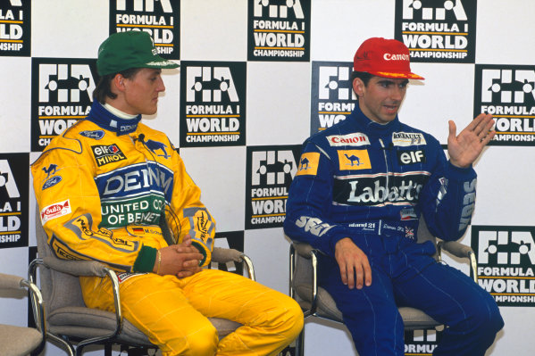 Silverstone, England. 9th - 11th July 1993.Michael Schumacher (Benetton B193B Ford) 2nd position, and Damon Hill (Williams FW15C Renault), retired, in converstation during a press conference, portrait.World Copyright: LAT Photographic.Ref:  Colour Transparency.