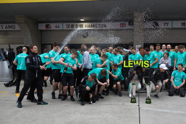 Shanghai International Circuit, Shanghai, China.  Sunday 9 April 2017. Lewis Hamilton, Mercedes AMG, 1st Position, and Valtteri Bottas, Mercedes AMG, celebrate with the Mercedes AMG team. World Copyright: Steve Etherington/LAT Images ref: Digital Image SNE28626