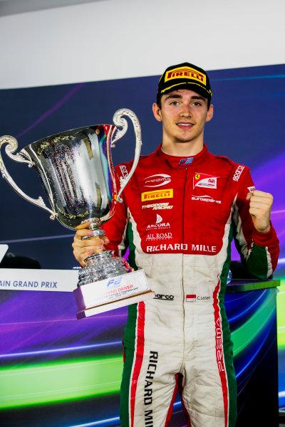 2017 FIA Formula 2 Round 1. Bahrain International Circuit, Sakhir, Bahrain.  Sunday 16 April 2017. Charles Leclerc (MCO, PREMA Racing), with the first place trophy. Photo: Zak Mauger/FIA Formula 2. ref: Digital Image _X0W5184