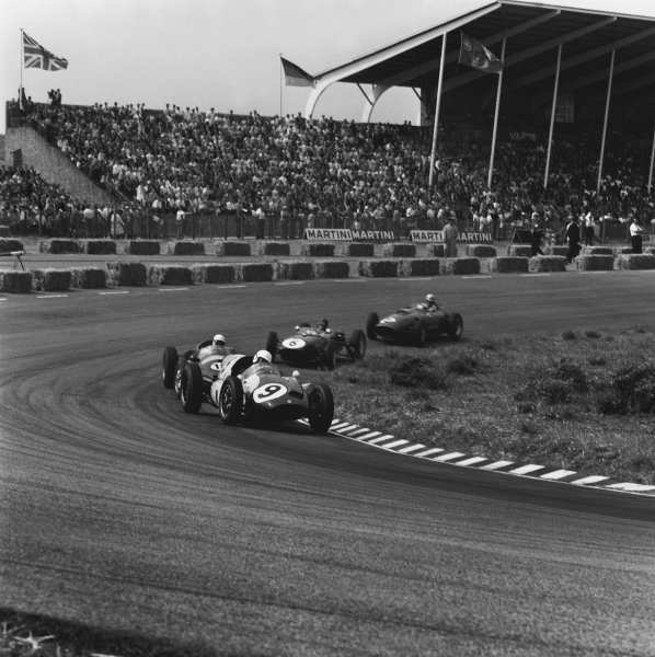 Zandvoort, Holland. 6th June 1960.Tony Brooks (Cooper T51-Climax), retired, leads Maurice Trintignant (Cooper T51-Maserati), retired, Jim Clark (Lotus 18-Climax), retired and Wolfgang von Trips (Ferrari Dino 246), 5th position, action. World Copyright: LAT Photographic.Ref:  6549