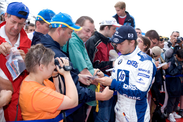2005 French Grand Prix - Thursday Preview,Magny-Cours, France 30th June 2005Nick Heidfeld, Williams F1 BMW FW27, signs autographs for his fans World Copyright: Steven Tee/LAT Photographic ref:Digital Image Only 48 mb file