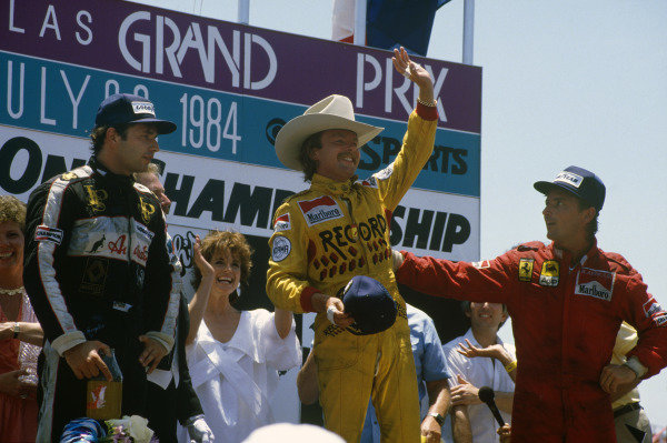 Fair Park, Dallas, Texas, USA. 6-8 July 1984. Keke Rosberg (Williams Honda) 1st position, Elio de Angelis (Team Lotus) 2nd position and Rene Arnoux (Ferrari) 3rd position on the podium. Ref: 84 DAL 07. World Copyright - LAT Photographic