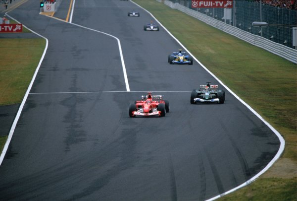 2003 Japanese Grand PrixSuzuka, Japan. 10th - 112th October 2003.Michael Schumacher, Ferrari F2003 GA, Mark Webber, Jaguar R4, actionWorld Copyright: Lorenzo Bellanca / LAT Photographic ref: 35mm Image 03JAP23