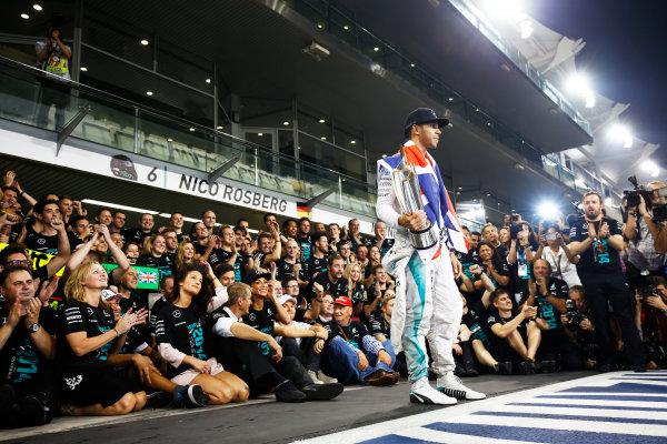 Yas Marina Circuit, Abu Dhabi, United Arab Emirates. Sunday 23 November 2014. Lewis Hamilton, Mercedes AMG, 1st Position, celebrates 2014 title success with his team. World Copyright: Andy Hone/LAT Photographic. ref: Digital Image _ONY2268