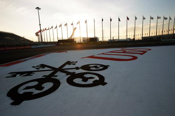 Sochi Autodrom, Sochi, Russia. Sunday 12 October 2014. The sun sets on the track. World Copyright: Charles Coates/LAT Photographic. ref: Digital Image _N7T7197
