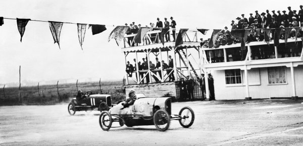 1920 Junior Car Club Meeting. Brooklands, England. 20th May 1920. H.R. Godfrey (10 h.p. G.N.), 1st position, leads C. Finch (10 h.p. G.N.), 2nd position, action.  World Copyright: LAT Photographic. Ref:  Autocar Glass Plate 4225.