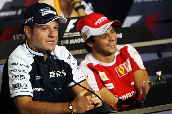 (L to R): Rubens Barrichello (BRA) Williams and Felipe Massa (BRA) Ferrari in the FIA Press Conference. Formula One World Championship, Rd 12, Hungarian Grand Prix, Preparations, Budapest, Hungary, Thursday 29 July 2010.