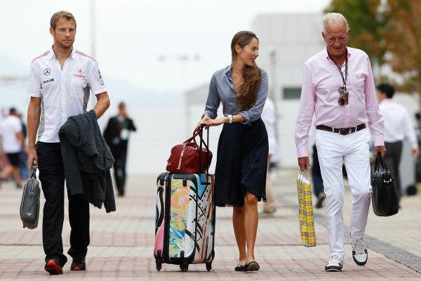 Korea International Circuit, Yeongam-Gun, South Korea. Sunday 6th October 2013. Jenson Button, McLaren, arrives with Jessica Michibata and John Button. World Copyright: Charles Coates/LAT Photographic. ref: Digital Image _N7T5313