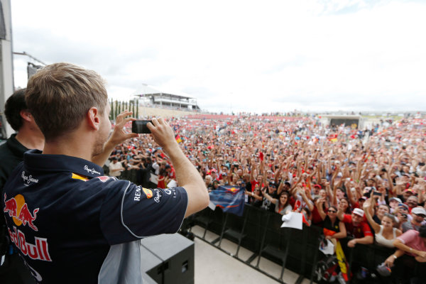 Circuit of the Americas, Austin, Texas, United States of America. Saturday 16th November 2013.  Sebastian Vettel, Red Bull Racing, takes a photo of the crowd. World Copyright: Charles Coates/LAT Photographic. ref: Digital Image _N7T9488