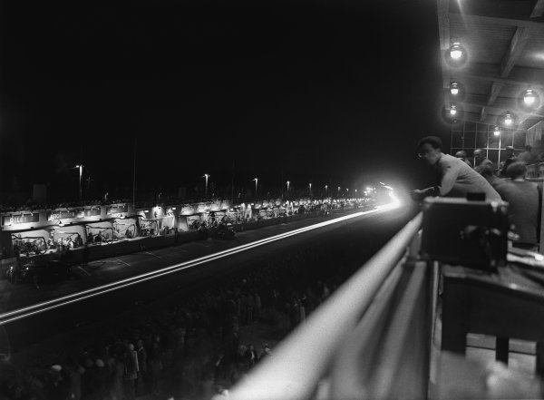 Le Mans, France. 24th - 25th June 1950 The main grandstand at night, atmosphere World Copyright: LAT Photographic Ref: Autocar Glass Plate C27269.