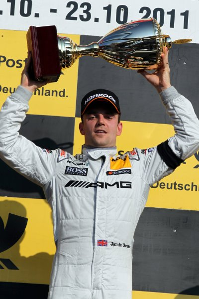 Race winner Jamie Green (GBR), AMG Mercedes, celebrates with his trophy on the podium.