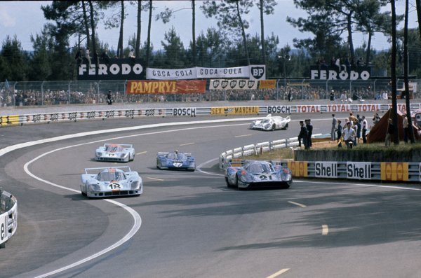 1971 Le Mans 24 hours. Le Mans, France. 12-13 June 1971. Pedro Rodriguez/Jackie Oliver,(#18) Porsche 917L, retired, is passed by Vic Elford/Gerard Larrousse,(#21) Porsche 917L and followed by Mark Donohue/David Hobbs,(#11) Ferrari 512M, retired and Jo Siffert/Derek Bell,(#17) Porsche 917L, retired. the eventual winners, Helmut Marko/Gijs van Lennep,(#22) Porsche 917K, follows at the rear, action. World Copyright: LAT Photographic Ref: 71LM48.