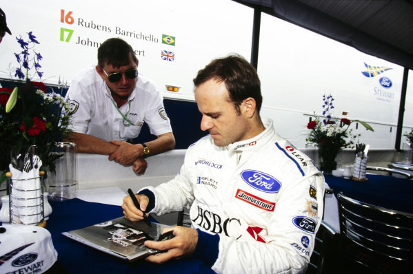 Rubens Barrichello signs an autograph.