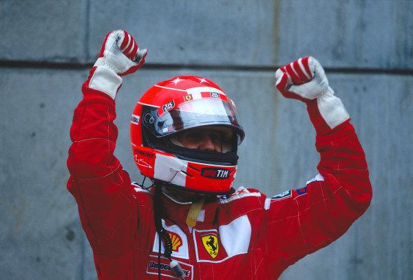 2000 United States Grand Prix.Indianapolis, Indiana, USA. 22-24 September 2000.Michael Schumacher (Ferrari) celebrates his 1st position in parc ferme.Ref-2K USA 53.World Copyright - LAT Photographic