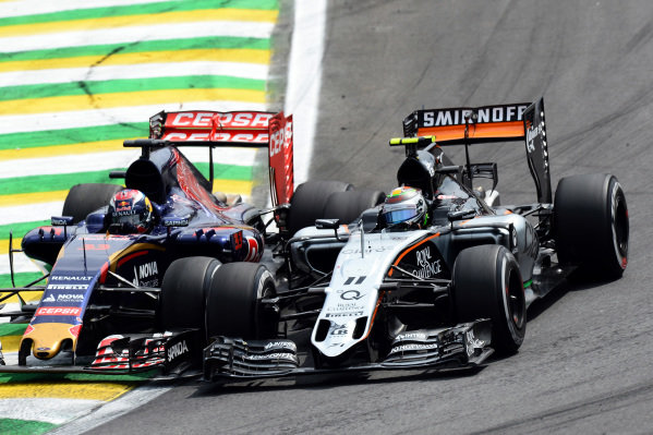 Max Verstappen (NED) Scuderia Toro Rosso STR10 battles with Sergio Perez (MEX) Force India VJM08 at Formula One World Championship, Rd18, Brazilian Grand Prix, Race, Interlagos, Sao Paulo, Brazil, Sunday 15 November 2015.