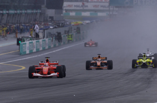 2001 Malaysian Grand Prix.Sepang, Kuala Lumpur, Malaysia. 16-18 March 2001.Rubens Barrichello (Ferrari F2001) followed by Jos Verstappen (Arrows A22 Asiatech) and Jarno Trulli (Jordan EJ11 Honda).World Copyright - LAT Photographicref: 8 9MB DIGITAL IMAGE