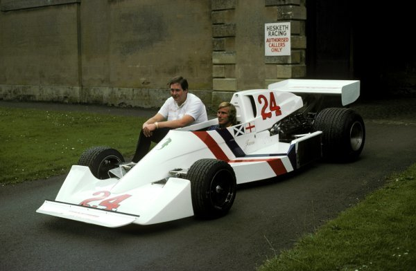 (L to R): Lord Alexander Hesketh (GBR) Le Patron (Team Owner) of Hesketh sits alongside James Hunt (GBR) in the new Hesketh 308C (That wasn't debuted until the non-championship Swiss GP in August 1975) at Hesketh headquarters in Towcester, nr Silverstone.  British Grand Prix, Silverstone, 19 July 1975. BEST IMAGE
