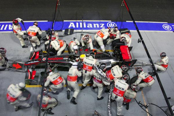 A pit stop for Lewis Hamilton, McLaren MP4-24 Mercedes.