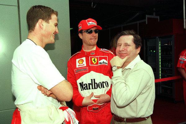 1999 Australian Grand Prix.Albert Park, Melbourne, Australia.5-7 March 1999.Ralf Schumacher (Williams Supertec), Eddie Irvine (Ferrari) and Ferrari Team Principal Jean Todt.World Copyright - Photo 4/LAT Photographic