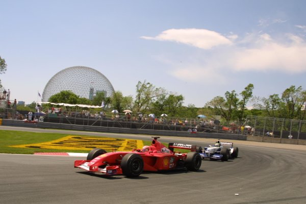 2001 Canadian Grand Prix - RACEMontreal, Canada. 10th June 2001.Michael Schumacher leads Ralf.World Copyright - LAT PhotographicRef: 8 9 MB Digital File Only