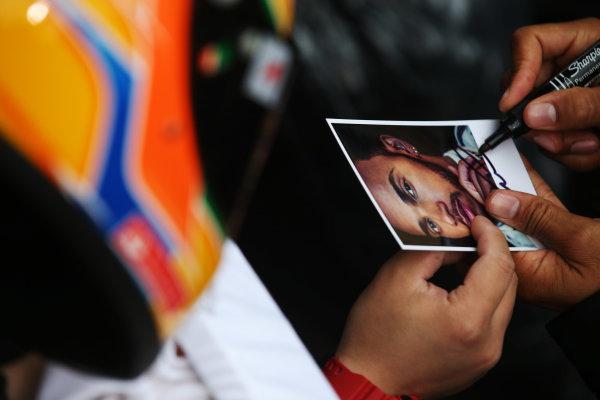 Shanghai International Circuit, Shanghai, China.  Thursday 06 April 2017. Lewis Hamilton, Mercedes AMG, signs autographs for fans. World Copyright: LAT Images ref: Digital Image GJ9R7587