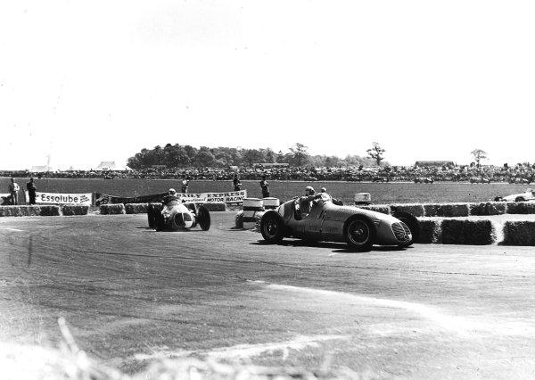 Silverstone, Great Britain.14 May 1949.Prince Bira leads Luigi Villoresi (both Maserati 4CLT/48).Ref-Autocar C24221.World Copyright - LAT Photographic