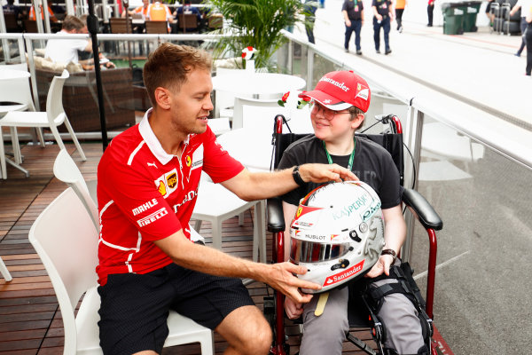 Circuit of the Americas, Austin, Texas, United States of America. Saturday 21 October 2017. Sebastian Vettel, Ferrari, meets a young fan. World Copyright: Sam Bloxham/LAT Images  ref: Digital Image _W6I7305