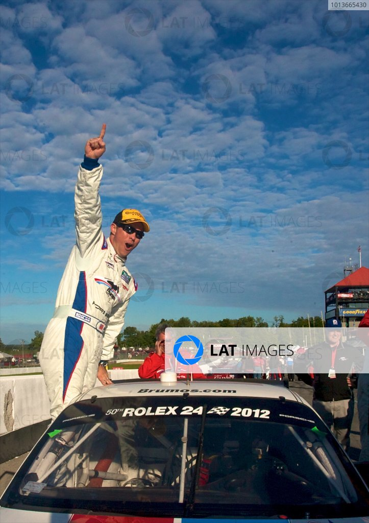 16-17 September, 2011, Lexington, Ohio USA Andre Davis celebrates his 2011 GT class Championship. (c)2011, R.D. Ethan LAT Photo USA