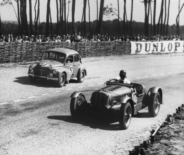 Le Mans, France. 25th - 26th June 1949.Tony Rolt/Jason Henry (Delahaye 135), retired, leads C. Hardy/Roger (Renault 4CV), retired, action. World Copyright: LAT Photographic.Ref: Autocar Used Pic 1st July 1949 Pg 633.
